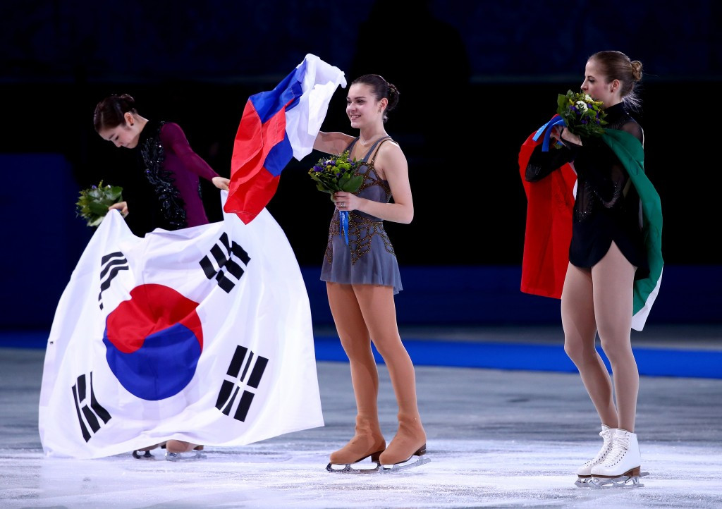 Adelina Sotnikova's controversial victory over Kim Yuna (left) during Sochi 2014 fuelled criticism of the anonymous judging system ©Getty Images