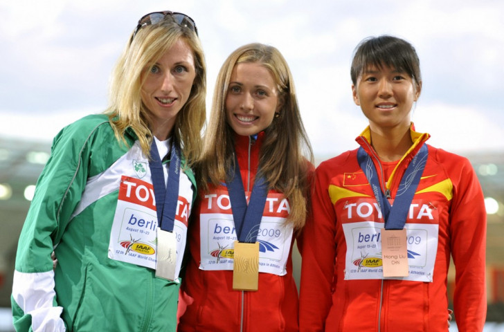 Ireland's Olive Loughnane pictured (left) after winning silver in the 20km walk at the 2009 IAAF World Championships, will receive the gold medal in a ceremony at next month's European Athletics Championships in Amsterdam following the doping ban imposed on Russia's original winner Olga Kaniskina ©Getty Images