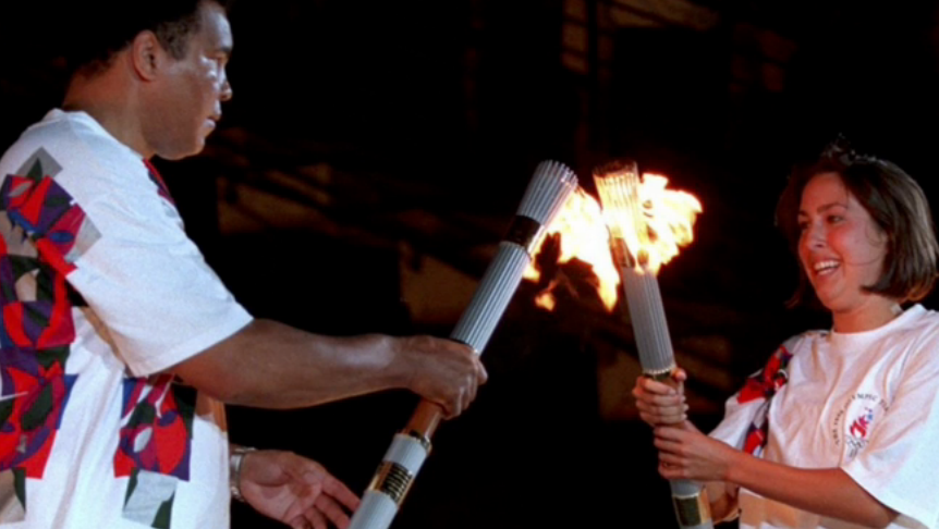 Janet Evans handed the Olympic Torch to Muhammad Ali at the Atlanta 1996 Opening Ceremony ©Getty Images