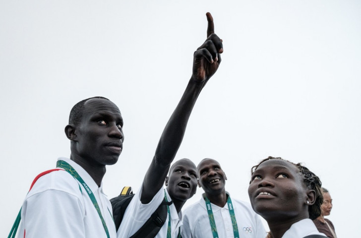 James Chiengjiek (left), Yiech Pur Biel (second left), coach Joseph Domongole and Rose Lokonyen take in the sights of Rio ahead of representing the Refugee Olympic Team ©Getty Images