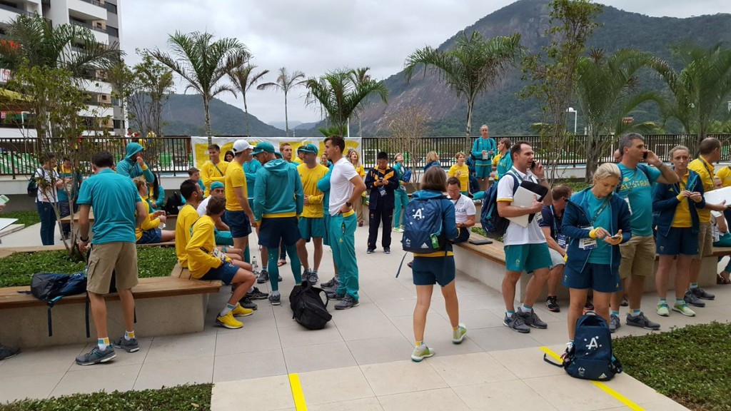 Australian athletes pictured outside their apartments in the Olympic Village following their evacuation after a fire ©Getty Images