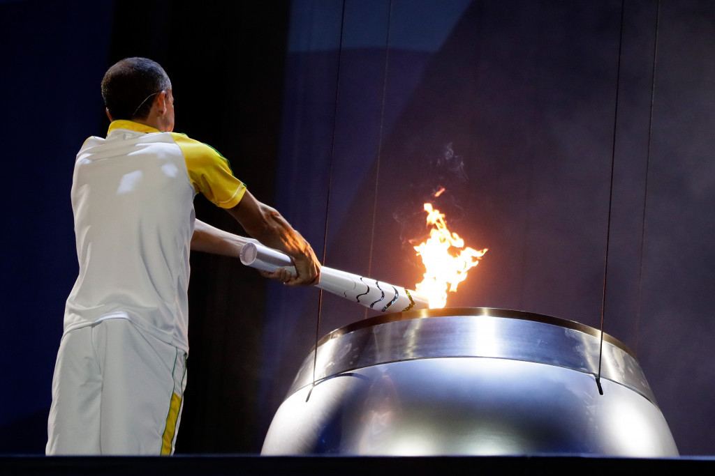 Vanderlei De Lima lit the Olympic Cauldron during the Opening Ceremony ©Getty Images