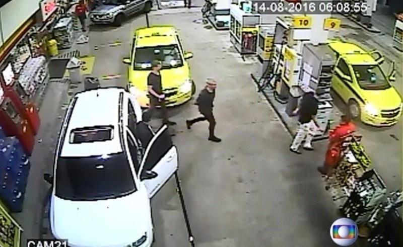 The swimmers have been accused of damaging a toilet door at a petrol station ©Globo TV