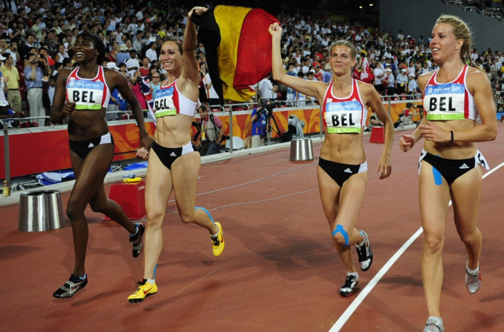 The Belgian women's 4x100m team - (from left) Elodie Ouedraogo, Kiim Gavaert, Olivia Borlee and Hanna Marien - celebrate their country's first medal at the Beijing 2008 Games. It was silver - now, following Russia's disqualification, it is gold, and they received their award in front of 40,000 home fans at the IAAF Diamond League final in Brussels ©Getty Images
