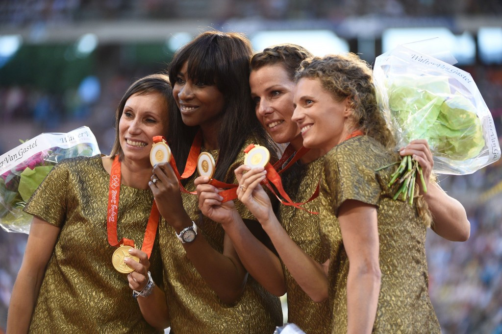 The Belgium women's 4x100m team show off their Olympic gold medals from Beijing 2008 after the belated re-award at the IAAF Diamond League final in Brussels ©Getty Images