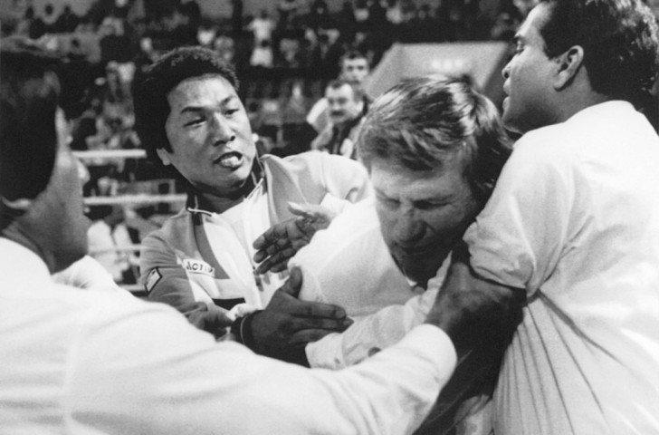 New Zealand referee Keith Walker is attacked by an South Korean official in the ring after the defeat of home boxer Byun Jong-il at the 1988 Olympics in Seoul - an incident many regard as the low point of Olympic boxing ©Getty Images
