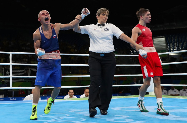 Vladimir Nikitin of Russia begins to celebrate his hugely controversial bantamweight quarter-final win over Ireland's Michael Conlan at Rio 2016 ©Getty Images