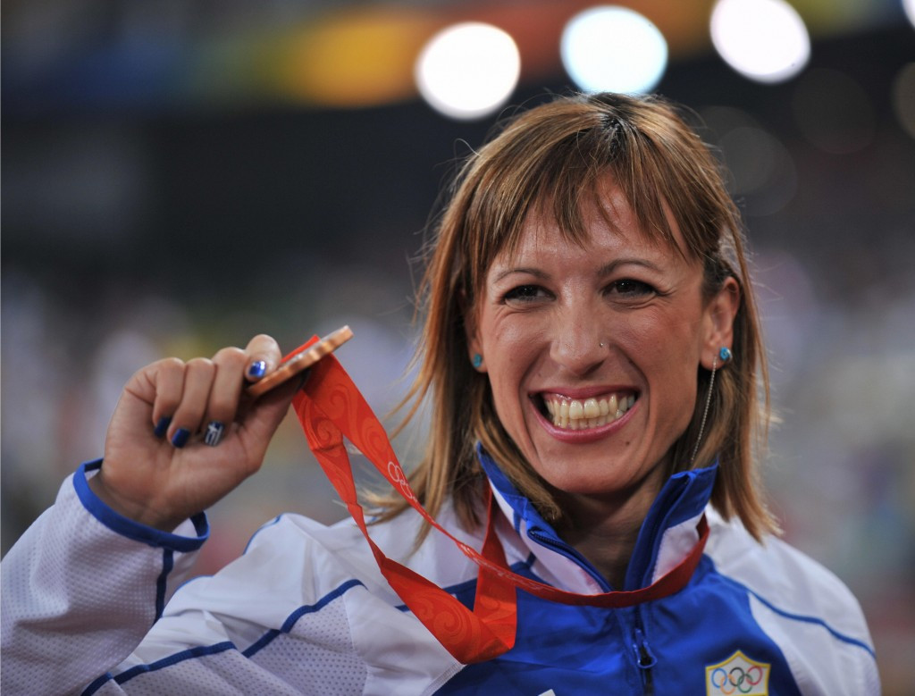 Hrysopiyi Devetsi of Greece shows off the Beiijing 2008 triple jump bronze medal which she has now forfeited following a re-analysis of her sample by the IAAF ©Getty Images