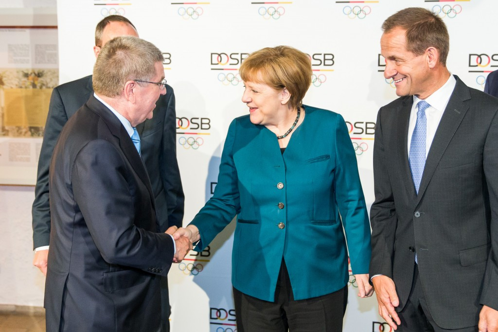 The recordings mention IOC President Thomas Bach (left) and German Chancellor Angela Merkel (centre)  ©Getty Images