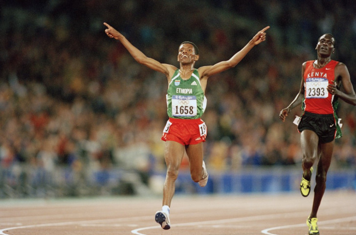 Haile Gebreselassie runs free to win the 2000 Olympics 10,000m gold - but his experiences as EAF President have left hiim feeling as if he has weights tied to his waist...©Getty Images