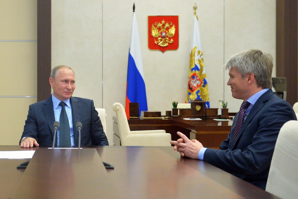 Russian Sports Minister Pavel Kolobkov (pictured, right) with Vladimir Putin, has criticised the stripping of the World Championships ©Getty Images