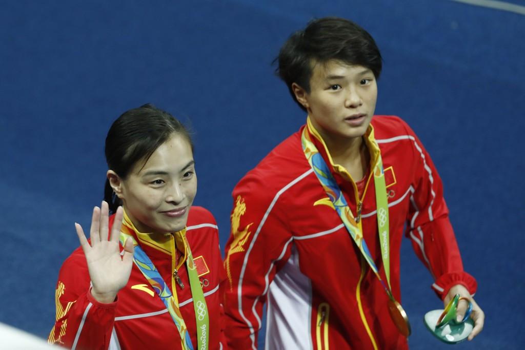 Wu Minxia (left) celebrates 3m synchronised gold at Rio 2016 alongside Shi Tingmao ©Getty Images