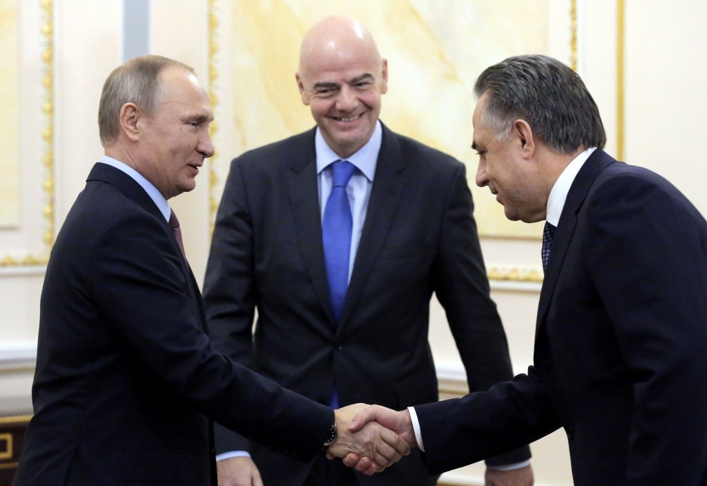 Russian President Vladimir Putin, left, and Deputy Prime Minister Vitaly Mutko, right, posing with FIFA boss Gianni Infantino. There appears no chance of Russia being stripped of the 2018 World Cup ©Getty Images