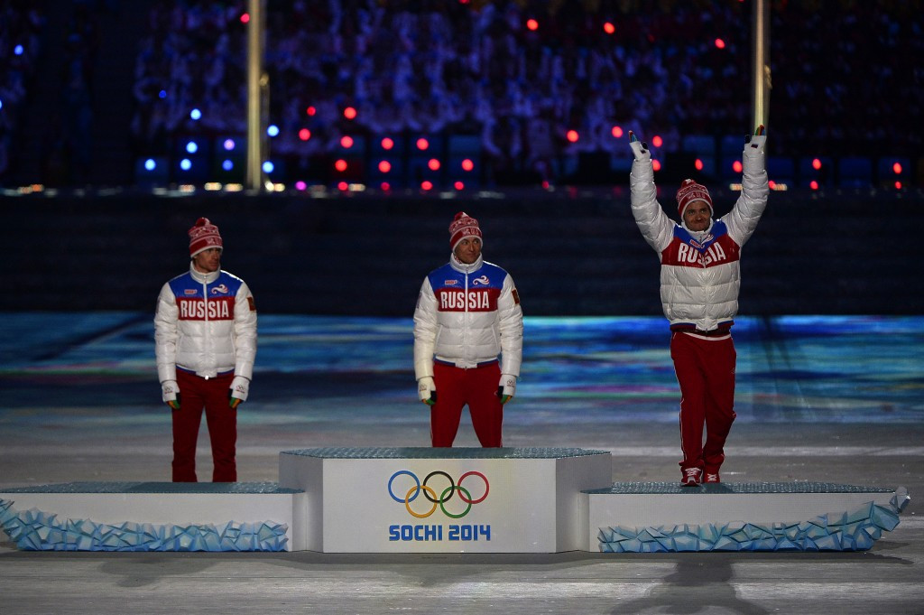 Banned Russian cross-country skier Maxim Vylegzhanin, left, received one of his three Olympic silver medal at the Closing Ceremony of Sochi 2014 ©Getty Images