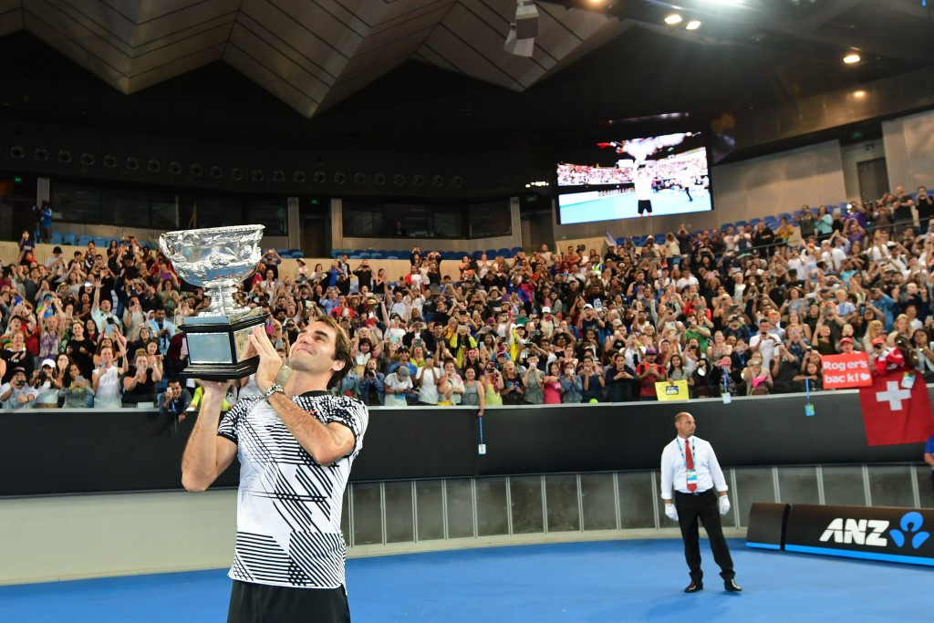 Roger Federer wields the Australian Open trophy after his five-set victory ©Getty Images