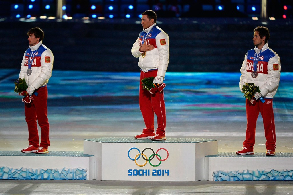 Aleksandr Legkov, centre, and Maxim Vylegzhanin, left, are among those under investigation after they won gold and silver in cross-country skiing at Sochi 2014 ©Getty Images