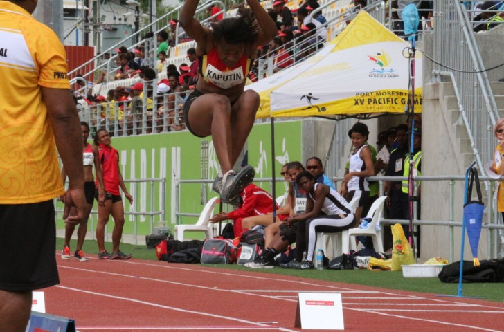 Papua New Guinea's Rellie Kaputin won her country's first gold medal of the day in the women's long jump, one of four her country were to win on this last day of competition in the Sir John Guise Stadium