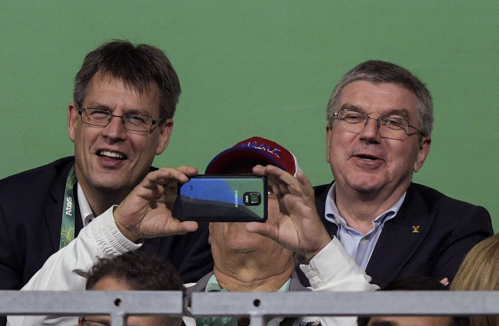 Thomas Weikert, left, pictured with International Olympic Committee President Thomas Bach, is Jean-Michel Saive's only rival in the campaign to become ITTF President ©Getty Images