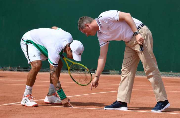 Taiwan's Lu Yen-Hsun and the umpire have a low-tech discussion about whether the ball was in or out during this year's French Open at Stade Roland Garros ©Getty Images