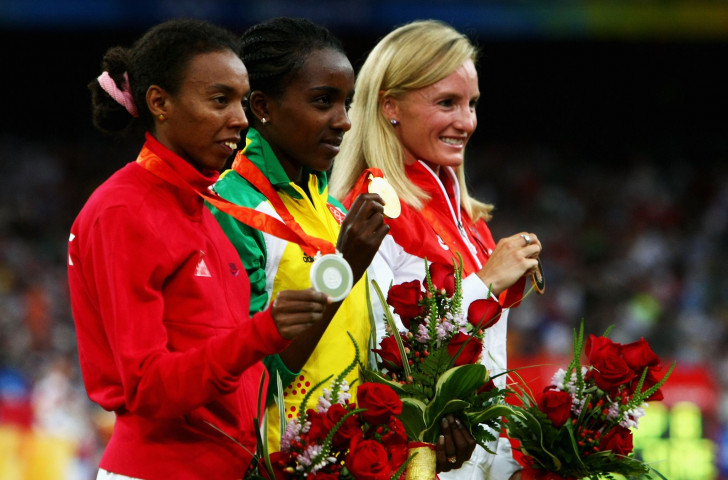 Shalane Flanagan of the United States, pictured with her bronze medal following the Beijing 2008 Olympics 10,000m final, has happily received her silver medal at home ©Getty Images