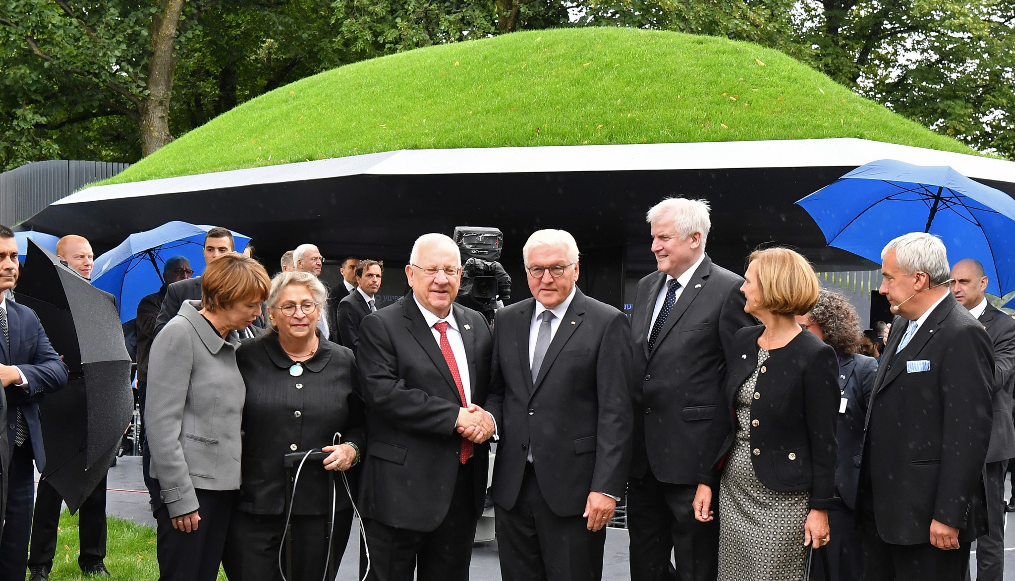 Israeli President Reuven Rivlin, left, and German President Frank-Walter Steinmeier, right, shake hands at the opening of the memorial for the victims of the Munich massacre ©Getty Images