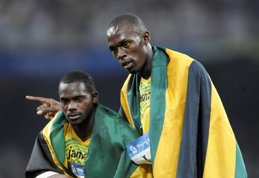 Usain Bolt, right, lost one of his nine Olympic gold medals after Nesta Carter, left, tested positive following a re-analysis of his doping sample from Beijing 2008 ©Getty Images