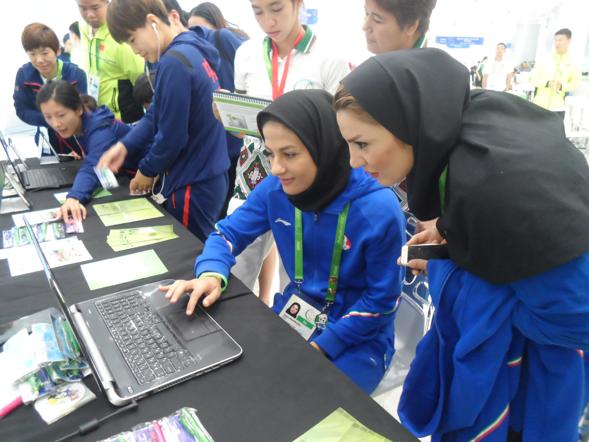 The outreach programme makes use of computer games, pamphlets, pens, t-shirts and stickers to attract the athletes ©OCA