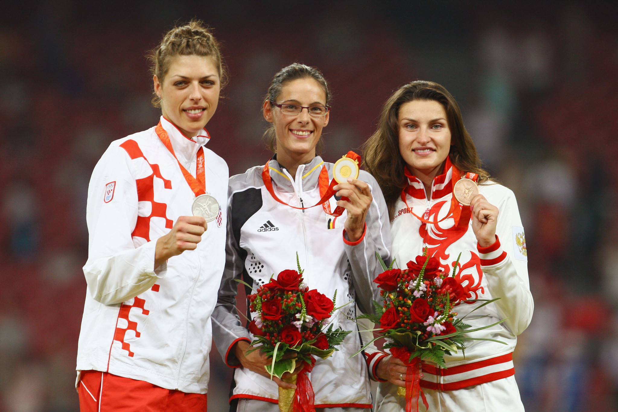 Anna Chicherova, right, pictured celebrating the bronze medal that she will now be stripped of ©Getty Images