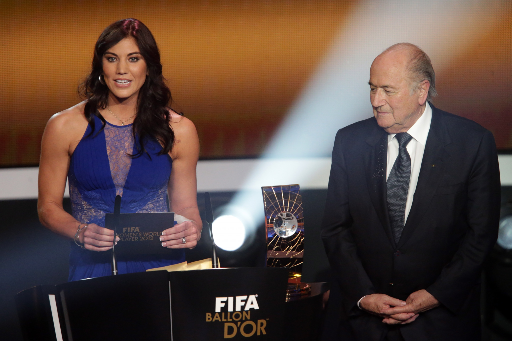 Hope Solo presenting at the 2013 Ballon d'Or Awards with Sepp Blatter, where she claims the sexual assault took place ©Getty Images