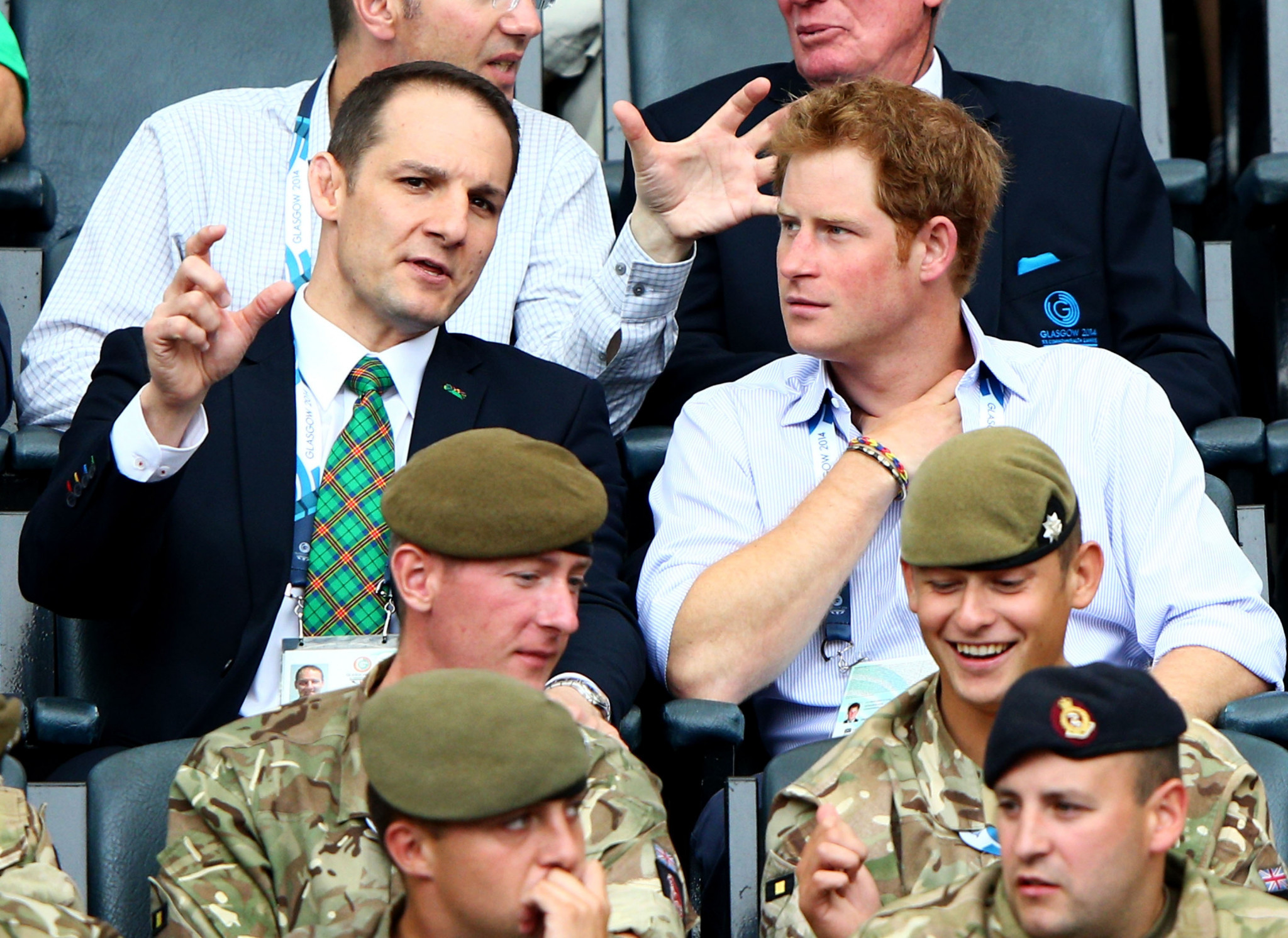 David Grevemberg, CBE, chief executive of the Commonwealth Games Federation, talks to Prince Harry at Hampden Park during Glasgow 2014 ©Getty Images