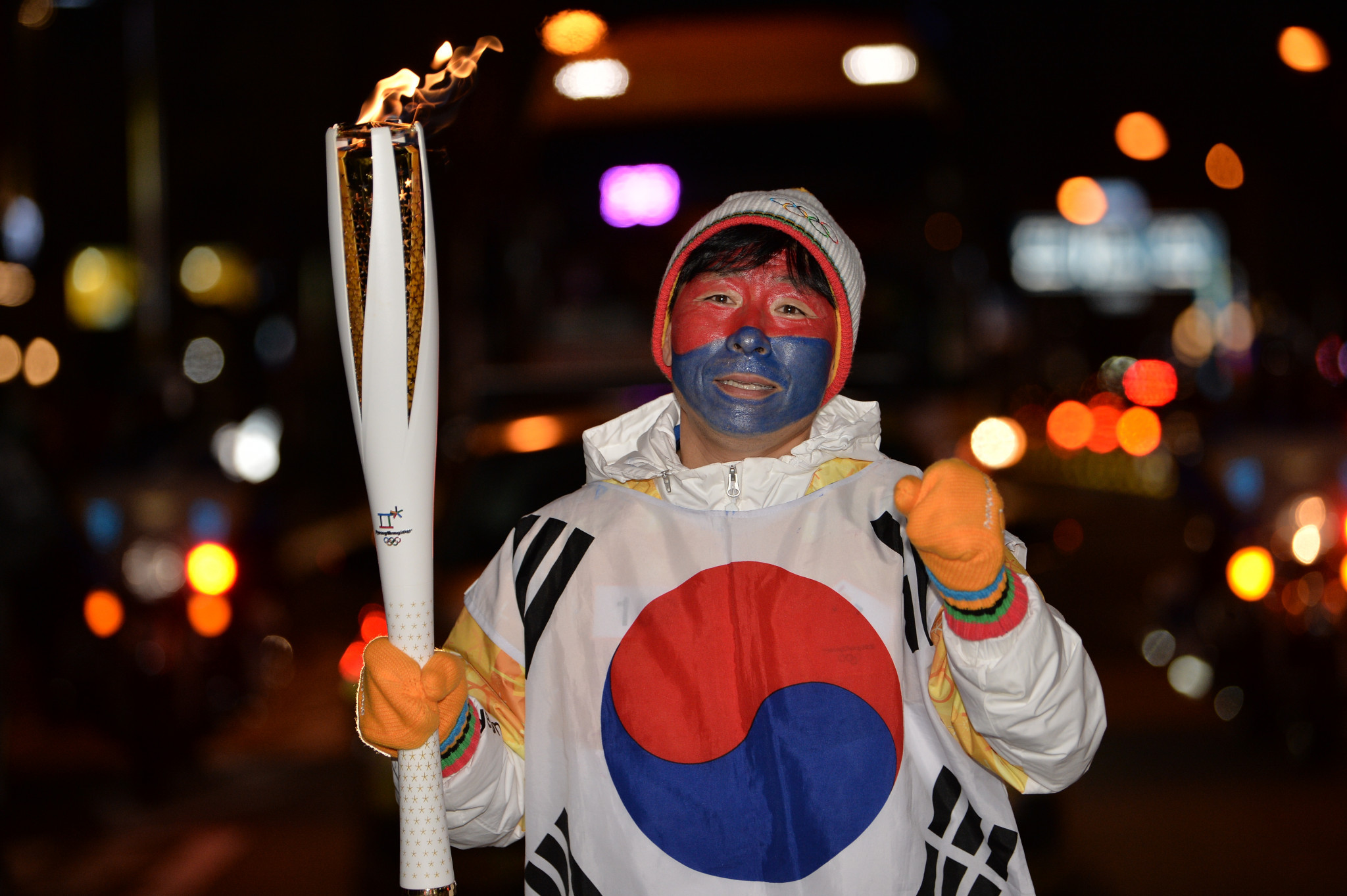 Torchbearers are extremely proud of their roles, as this gentleman proves with his painted face ©Pyeongchang2018
