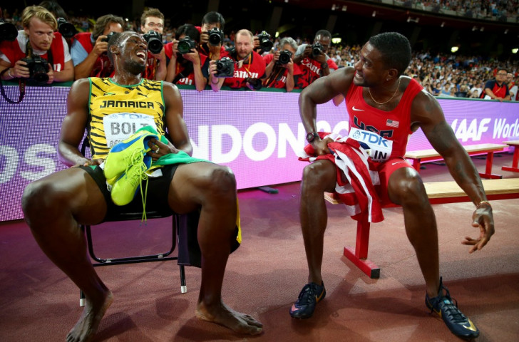 Usain Bolt (left) chats to silver medallist Justin Gatlin of the United States after retaining his world 200m title in 19.55sec  ©Getty Images