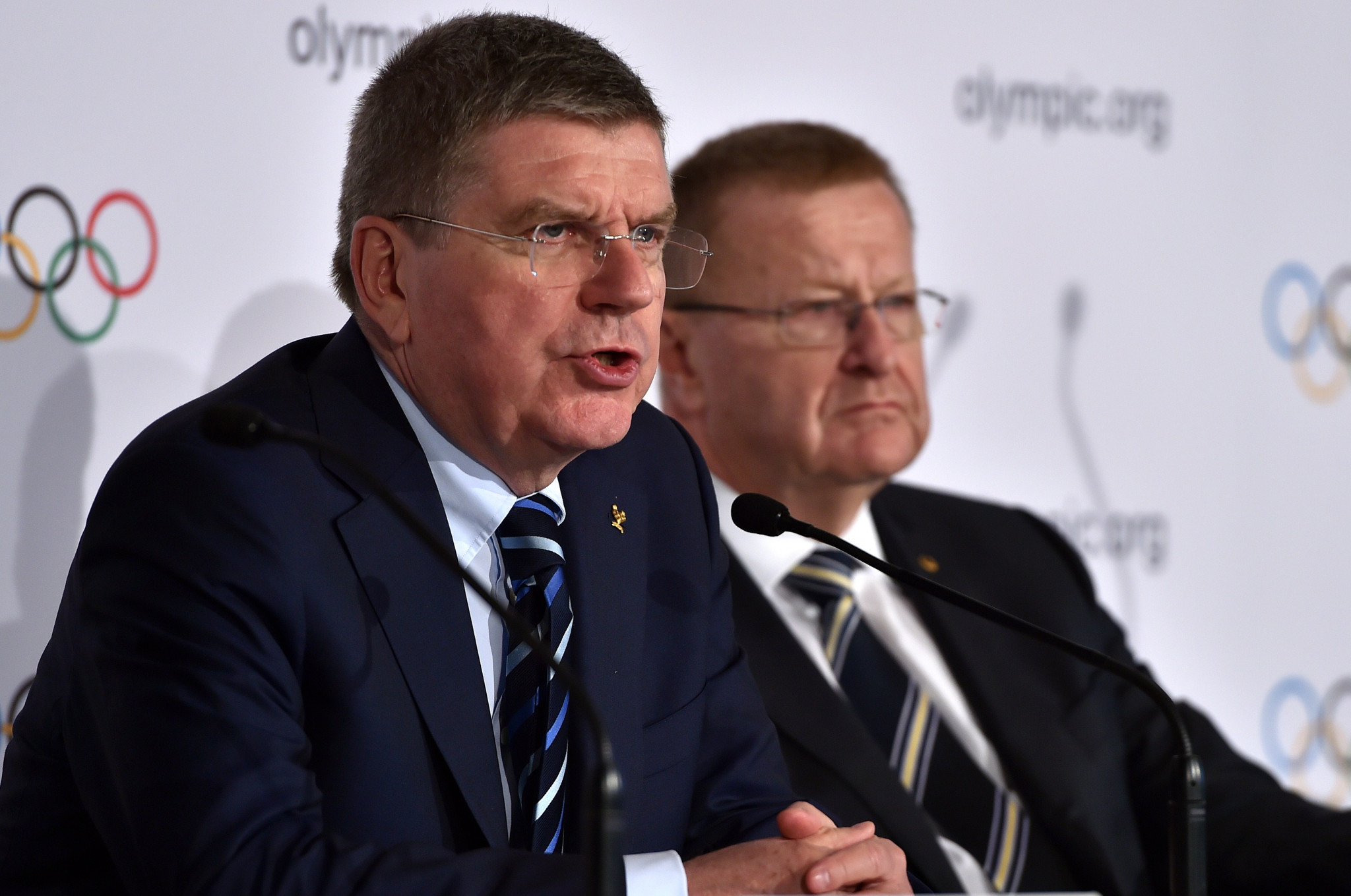 Thomas Bach, left, alongside former IOC vice-president John Coates, the President of the Court of Arbitration for Sport, a figure widely seen as a close ally of the German ©Getty Images