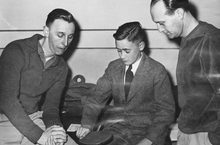 Britain's world table tennis champion Johnny Leach, left, and former world champion Victor Barna offer tips on technique in 1951 before new bat designs and tactics changed the game, heralding the rise of Asian players ©Getty Images.