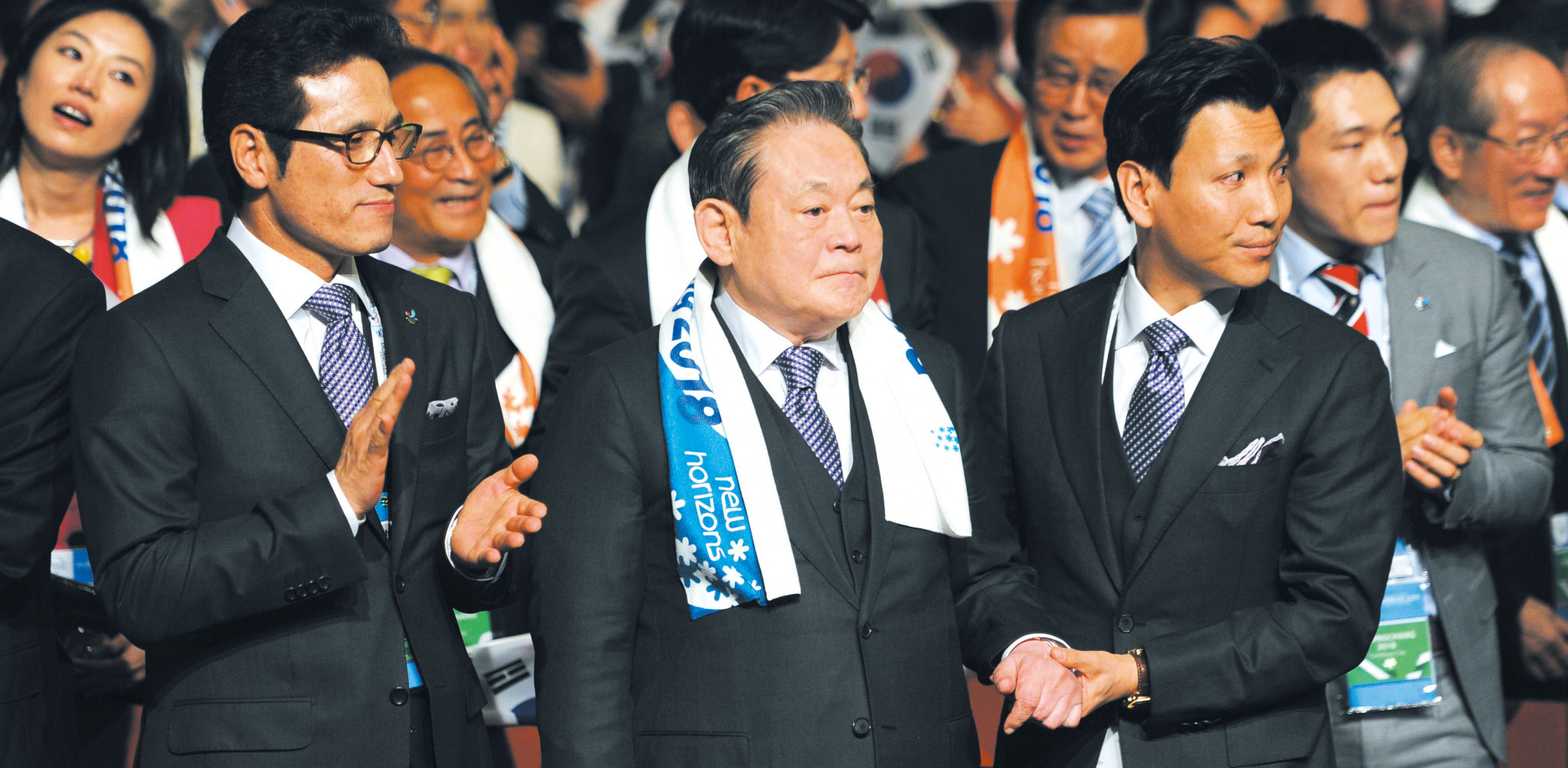 Samsung chairman Lee Kun-hee, centre, played a key role in Pyeongchang's successful bid for the 2018 Winter Olympic and Paralympics after receiving a Presidential pardon allowing him to be reinstated as an IOC member ©Getty Images