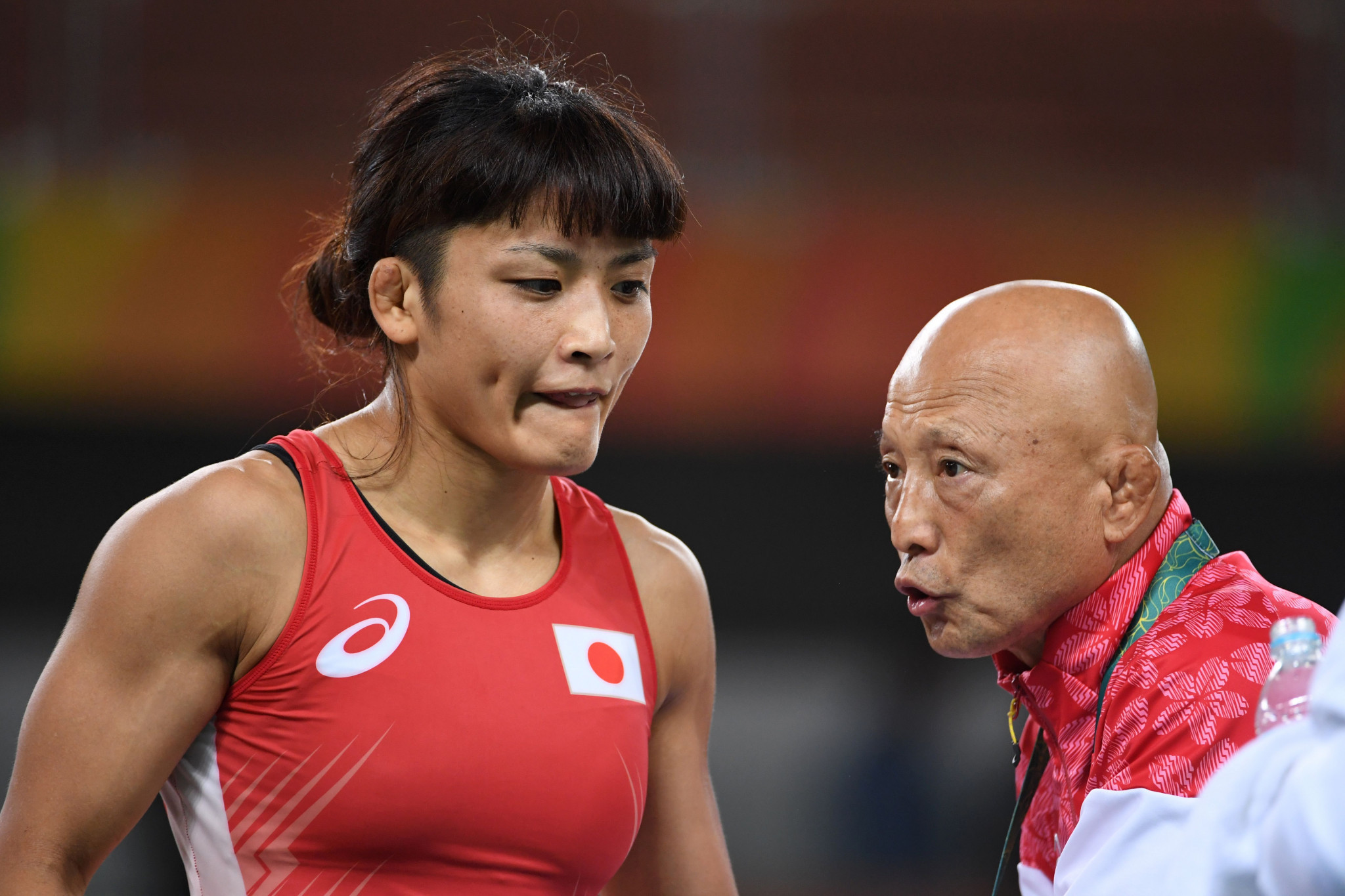 Four-time Olympic gold medallist Kaori Icho, left, was harassed by Kazuhito Sakae, the Japan Wrestling Federation's development director, right, it has been claimed ©Getty Images