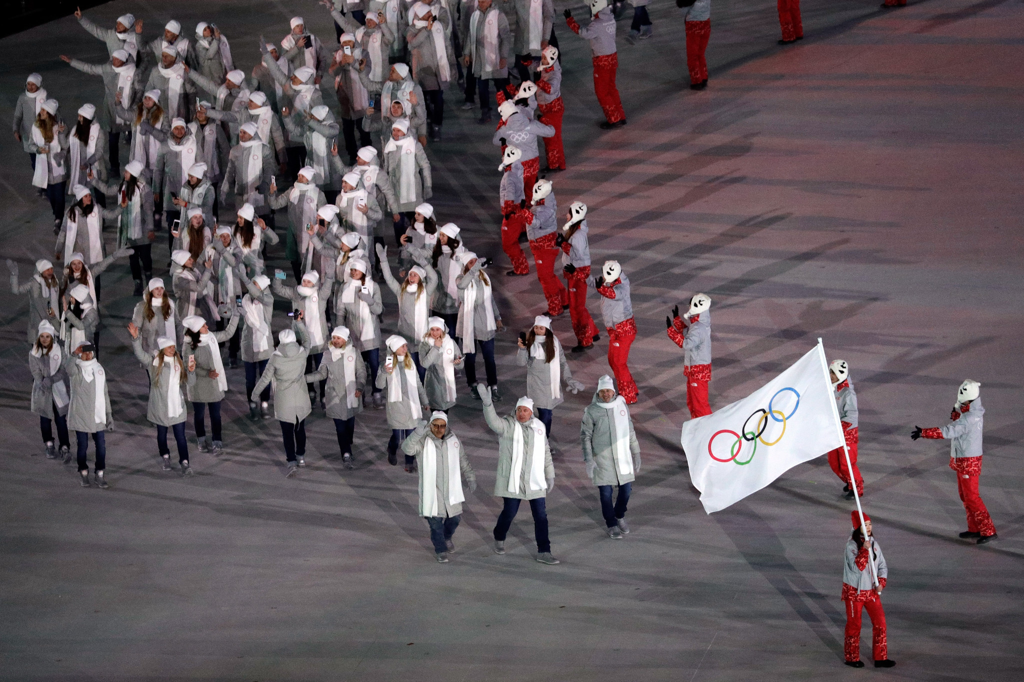 A volunteer also carried the neutral flag for the OAR team at the recent Olympic Games ©Getty Images